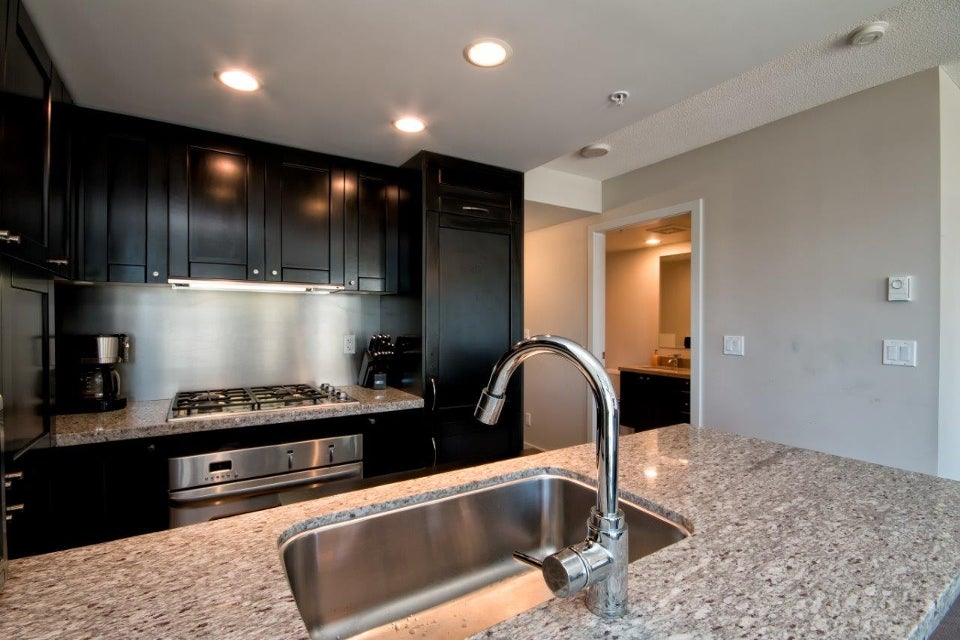 Gleaming granite and custom cabinetry in the entertainer's kitchen